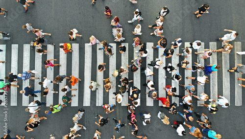 plakat Aerial. People crowd on pedestrian crosswalk. Top view background.