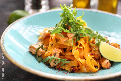 Tagliatelle with grilled salmon in a cream sauce with the addition of white wine Fototapeta