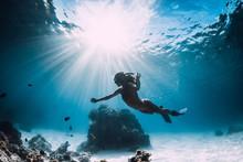 Woman Freediver With Fins Swim...