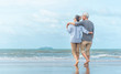 canvas print picture - Happy senior couple on the beach. Exotic luxury resort.back view.