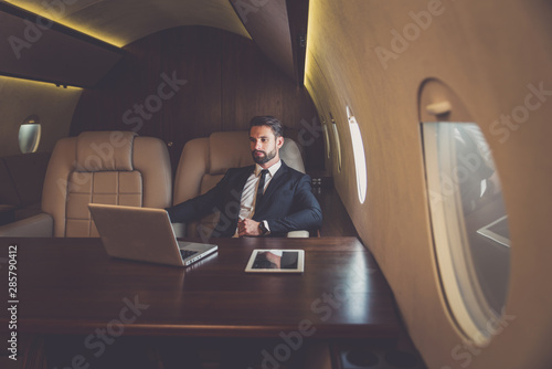 Poster Personal Businessman flying on his private jet