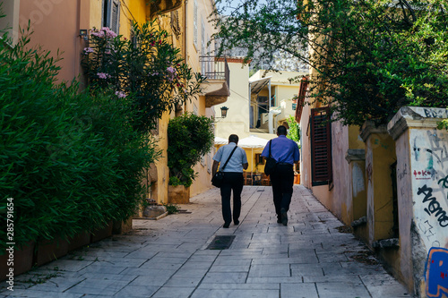 Two men walking away in the oldtown of Athens Canvas Print