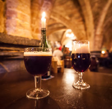 Two Glasses Of Craft Beer In A Typical Belgian Pub.