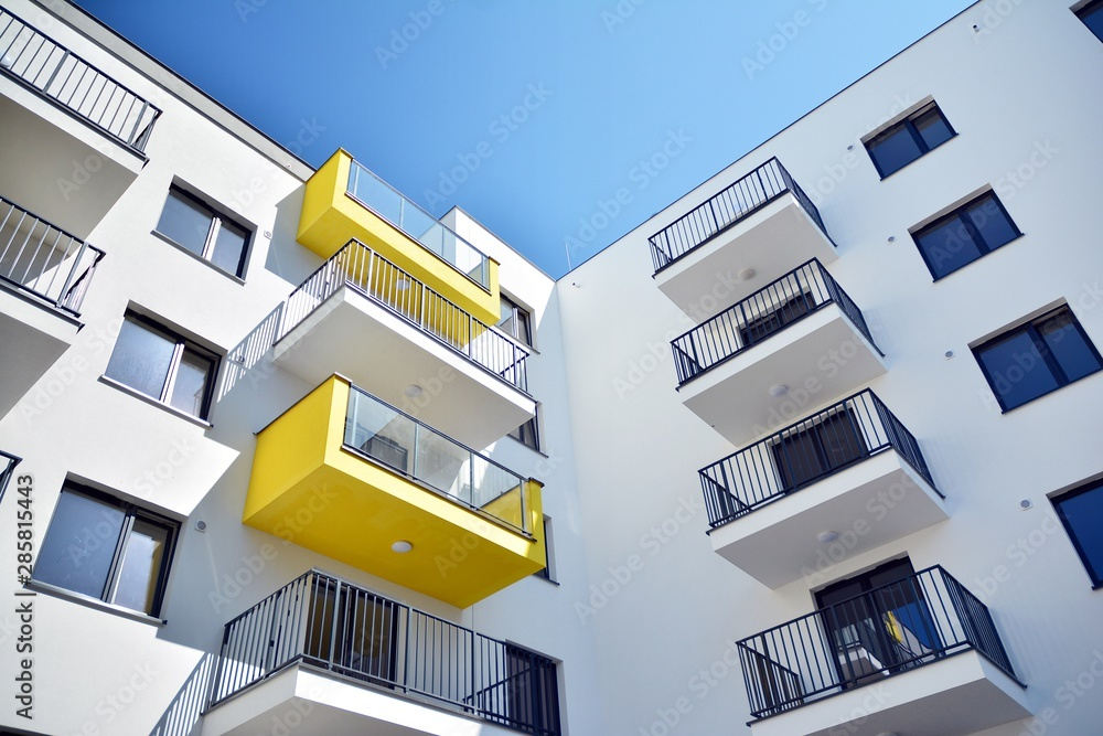 Fototapeta Modern apartment buildings on a sunny day with a blue sky. Facade of a modern apartment building