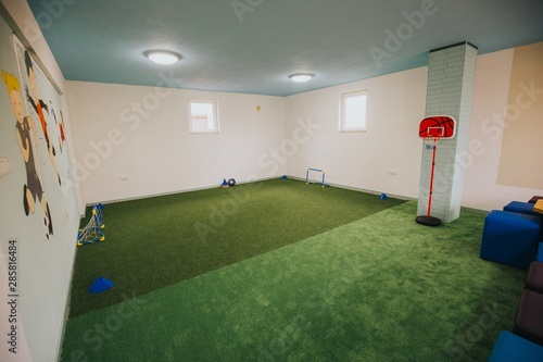 Obraz Wide shot of boys and girls playground area at a daycare center - fototapety do salonu