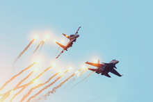 Two Combat Fighters Jet Perform An Air Battle With The Firing Of Warheads With Explosions.