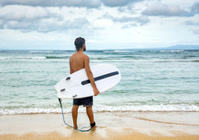 Surfer Man Holding Surf Board Standing In The Ocean