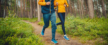 Couple Running Forest Trail. F...