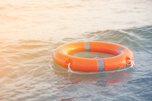 Orange Lifebuoy Lies On The Sh...