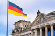 canvas print picture - Reichstag building architecture and German Flags at Berlin