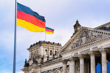 Reichstag Building Architecture And German Flags At Berlin