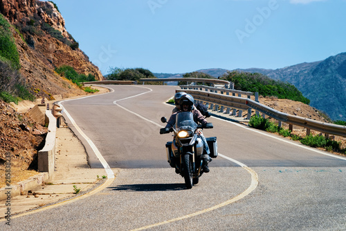 Motorcycle in road in Costa Smeralda Canvas Print
