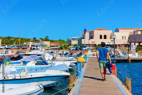 Foto auf AluDibond Schiff Man in Old Sardinian Port with ships Mediterranean Sea Vilasimius