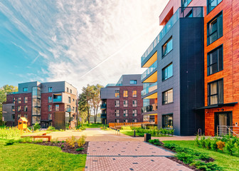 Benches at Modern european complex of apartment buildings