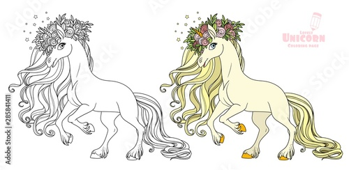 Tablou Canvas Magical unicorn in a magnificent wreath of roses standing on hind legs color and