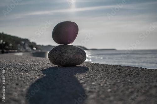 Acrylic Prints Stones in Sand морские камни на фоне моря