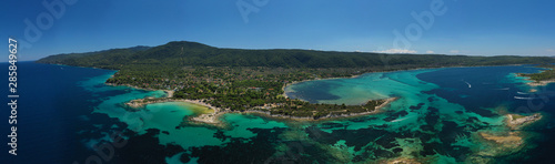 Obraz Aerial drone panoramic photo of iconic bay with turquoise frozen waves of Vourvourou in Sithonia Peninsula, Halkidiki, North Greece - fototapety do salonu
