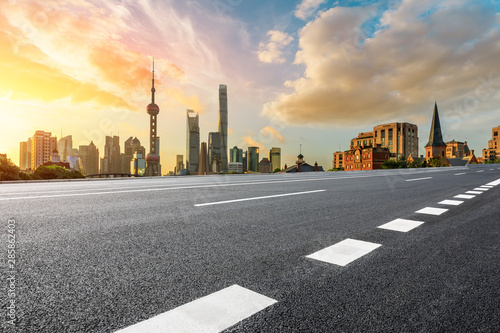 Fototapeta Empty highway and beautiful city buildings scenery at sunrise in Shanghai,China. obraz na płótnie