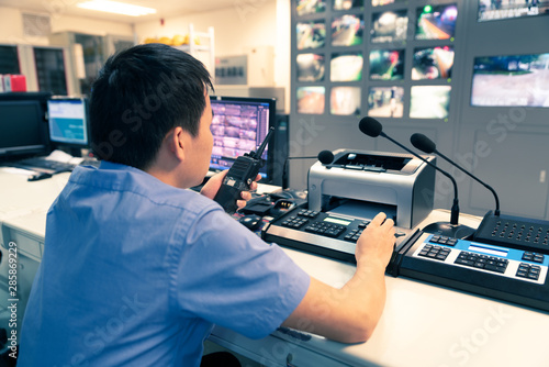 Photo System Security Specialist Working at System Control Center