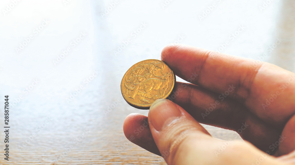 Fototapety, obrazy: Close the Holding Australian Dollars Coin on Hand and Finger