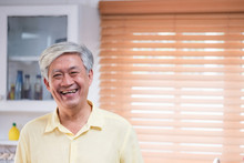 Asian Senior Man Smile In Livi...