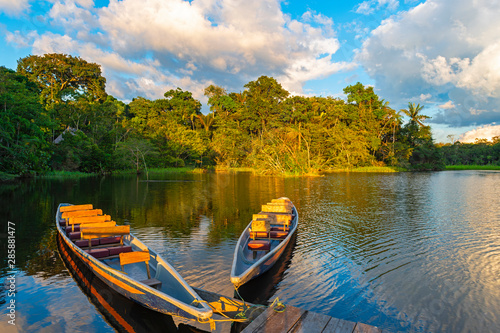 Two traditional wooden canoes at sunset in the Amazon River Basin with the tropical rainforest in the background inside the Yasuni National Park, Ecuador, South America Canvas Print