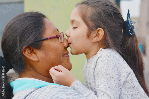 Tender portrait of native american woman with her little daughter Canvas Print