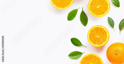 Fotografía  Fresh orange citrus fruit with leaves isolated on white background