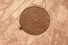 Brown Manhole Cover