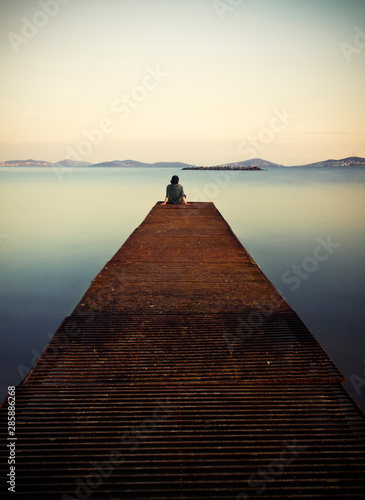Young man standing on a pier