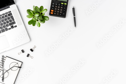 Office desktop with laptop, calculator and business accessories isolated on white background Wallpaper Mural