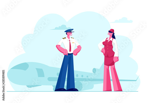 Photo Aviation Aircrew Characters Pilot with Arms Akimbo and Stewardess Wearing Uniform Posing on Airport with Flying Jet Plane Background