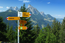 Clear Swiss Mountain Path Signs Near A Walking Path. The Location Of This Sign Post Is Gruebli.