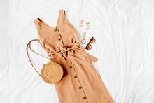 Beige Dress With Bamboo Bag An...