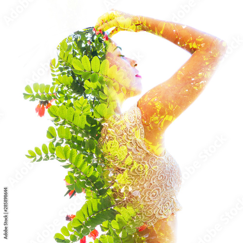 Double exposure of a young long haired woman blended with bright tropical leaves Wallpaper Mural