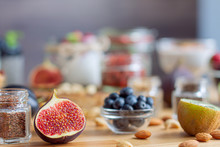 Closeup Glass Jar With Chia Seeds And .figs On Background Bokeh. Light Summer Natural Breakfast With Dairy Products, Nuts, Fruits And Berries. Fitness Diet Nutrition. Healthy Life And Food Concept.