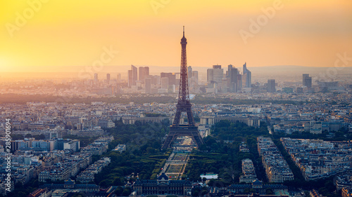Fototapeta Panoramic aerial view of Paris, Eiffel Tower and La Defense business district. Aerial view of Paris at sunset. Panoramic view of Paris skyline with Eiffel Tower and La Defense. Paris, France. obraz na płótnie