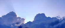 Detailed High Resolution Panorama Of Dramatic Clouds In The Sky With Sunlight Coming Through The Clouds
