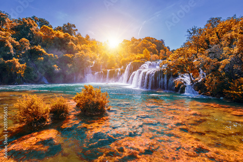 Photo Stands Forest river Krka national park with autumn colors of trees, famous travel destination in Dalmatia of Croatia. Krka waterfalls in the Krka National Park in autumn, Croatia.