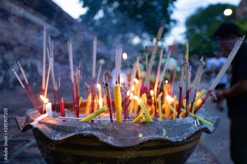 Foto auf AluDibond Buddha Burning incense sticks in a Buddhist Temple in Thailand.