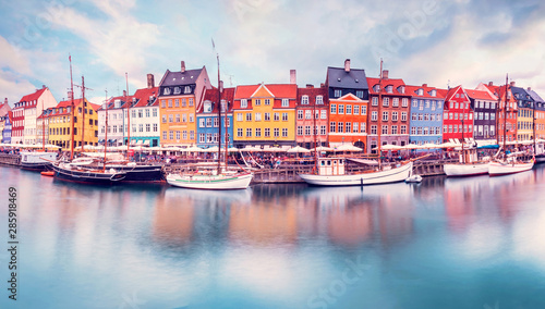 Unmatched magical fascinating landscape with boats in a famous Nyhavn in the capital of Denmark Copenhagen Wallpaper Mural