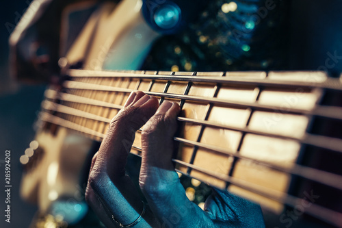 Fototapeta Closeup photo of bass guitar player hands obraz