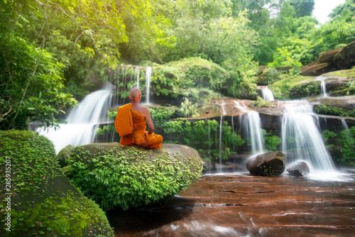 Obraz Buddha monk practice meditation at beautiful waterfall - fototapety do salonu