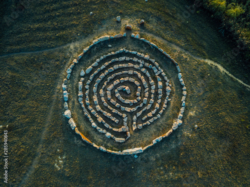 Photo sur Toile Spirale Spiral labyrinth made of stones, top view from drone
