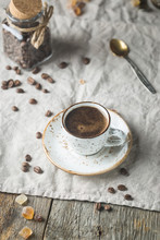 Hot Coffee Cup And Coffee Beans On The Wooden Table, Rustic Style