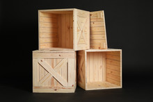 Group Of Wooden Crates On Black Background