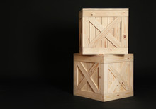 Wooden Crates On Black Background. Space For Text