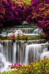 Fototapeta Wodospad amazing of huay mae kamin waterfall in colorful autumn forest at Kanchanaburi, thailand