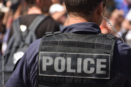 Fototapeta French policeman photographed from behind during a protest