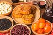 Leinwanddruck Bild - Traditional mooncakes on table setting with teacup.